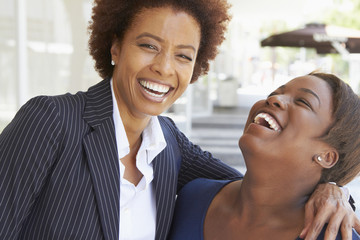 Laughing African American mother and daughter