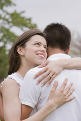 Hispanic couple hugging outdoors
