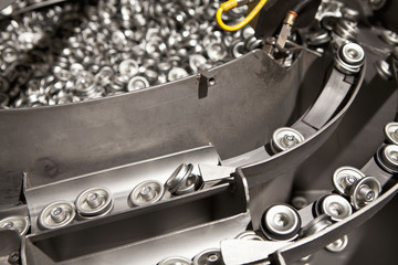 Metal can tops on assembly line