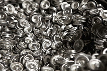 Pile of metal can tops