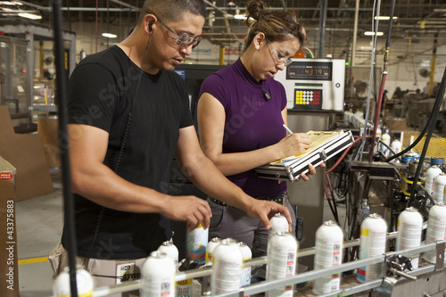 Hispanic workers working on assembly line