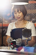 Chinese woman working in electronics factory