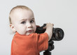 young child with digital camera