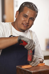 Hispanic man working in electronics factory