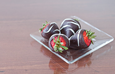 Four chocolate covered strawberries