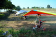 colorful hang gliders ready for the take off - 43376686