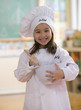 Caucasian girl dressed as chef