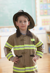 Caucasian boy dressed as fireman