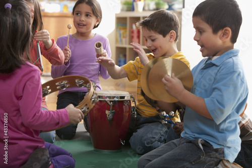 Students playing musical instruments in classroom