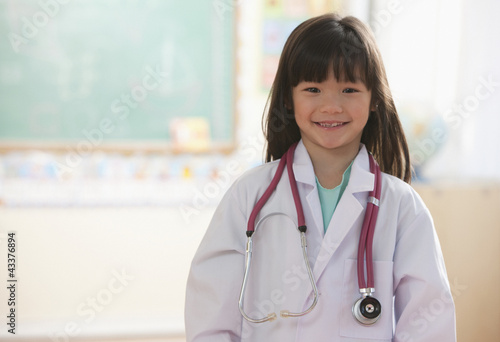 Mixed race girl dressed as doctor