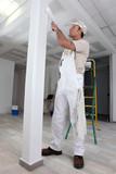Tradesman painting a column poster