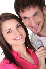 Couple singing into a microphone