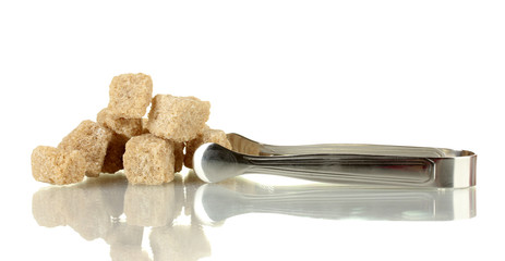 brown cane sugar cubes with sugar-tongs isolated on white