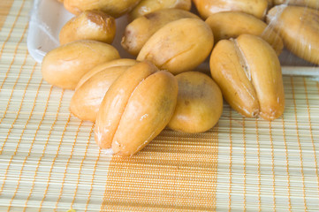 closeup of Thai sweet fruit,Zalacca on bamboo pad