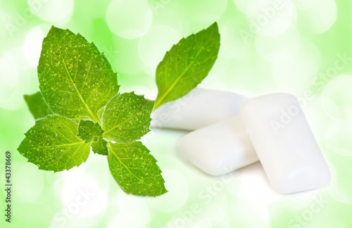 Chewing gym and fresh leaves of mint