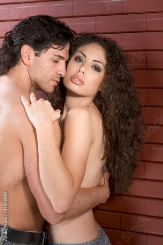 Young naked Man and woman in love are kissing