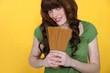 Woman holding raw spaghetti