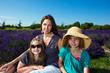 A pretty Mom with her beautiful children in lavender field