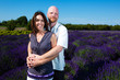 Happy middled aged couple in a field of purple lavender