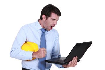 Architect shouting at laptop