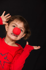 Funny little girl wearing red nose