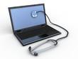 Stethoscope on black laptop