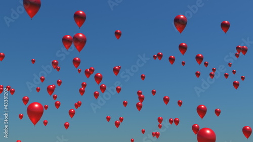 A sky full of red balloons floating upwards.