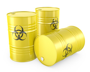 Three yellow barrels with biohazard symbol