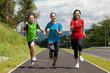 Active family - mother and kids running outdoor