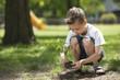 Little boy planting