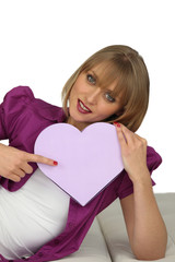 Woman with a heart-shaped box