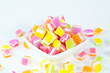 A pile of candies on a white background. Close-up of colorful ca