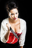 attractive brunette woman with bloody knife