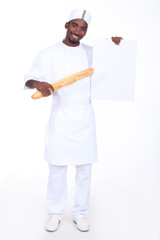 Bakery worker holding baguette and poster