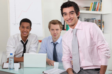Three men in an office