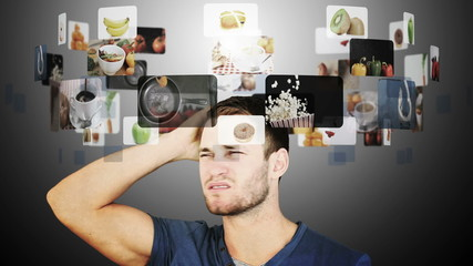Brunette man hesitating between slow motion videos of food