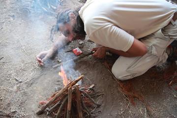 lighting a fire camp