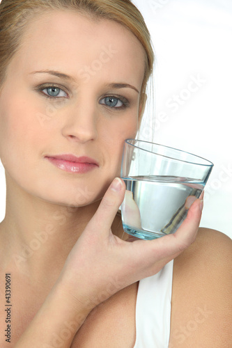 Young woman holding a glass of water