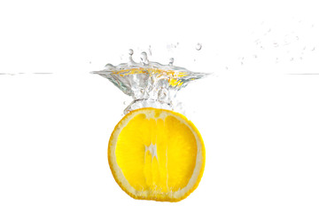 Sliced fresh lemon falling into the water with a splash