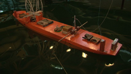 Testing the model of a ship in the pool.