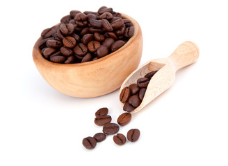 coffee beans in the wooden spoon, isolated on white background
