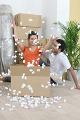 couple amid boxes