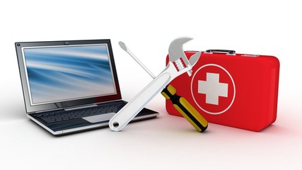 Laptop with tools and a first aid kit on a white background