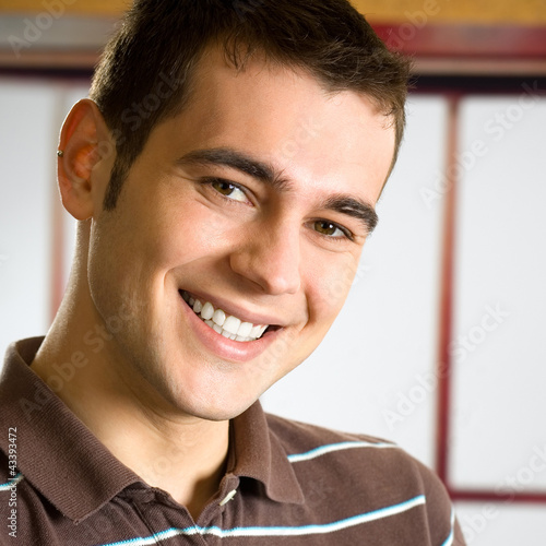 Portrait of happy smiling young man