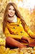young brunette woman portrait in autumn color