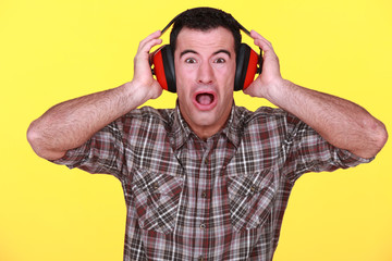 craftsman wearing headphones can't stand the noise