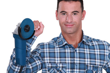 Yourselfer holding a sander