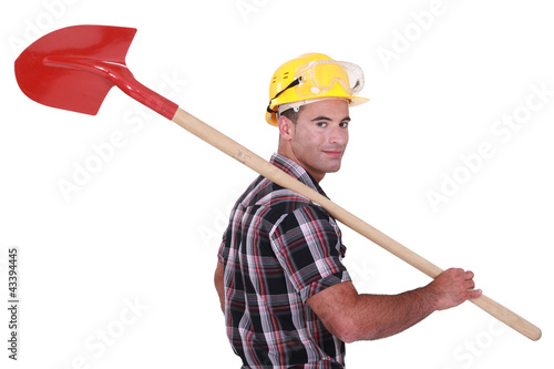 A handyman with a shovel.