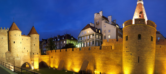 Night panorama view of castle in Warsaw old town. Poland