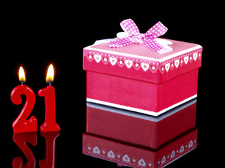 Birthday  gift with red candles showing Nr. 21